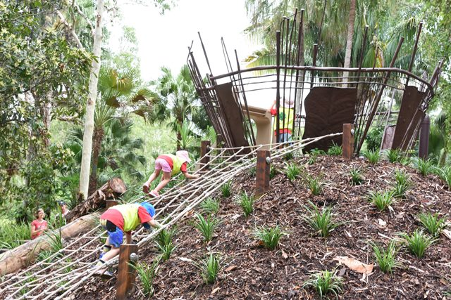 The Nature Play space incorporates creative play elements like these ropes to climb.
