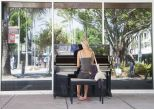 Busker Playing Piano